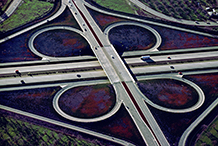 Freeway interchange with wild flowers.  1973